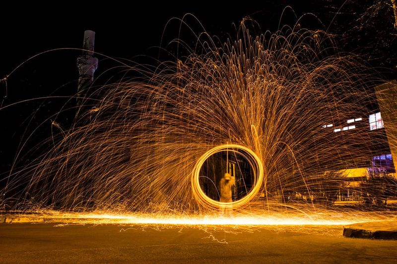 Man Playing With Fireworks At Night