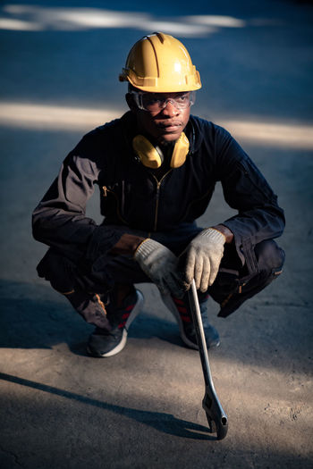 Man wearing hat sitting outdoors