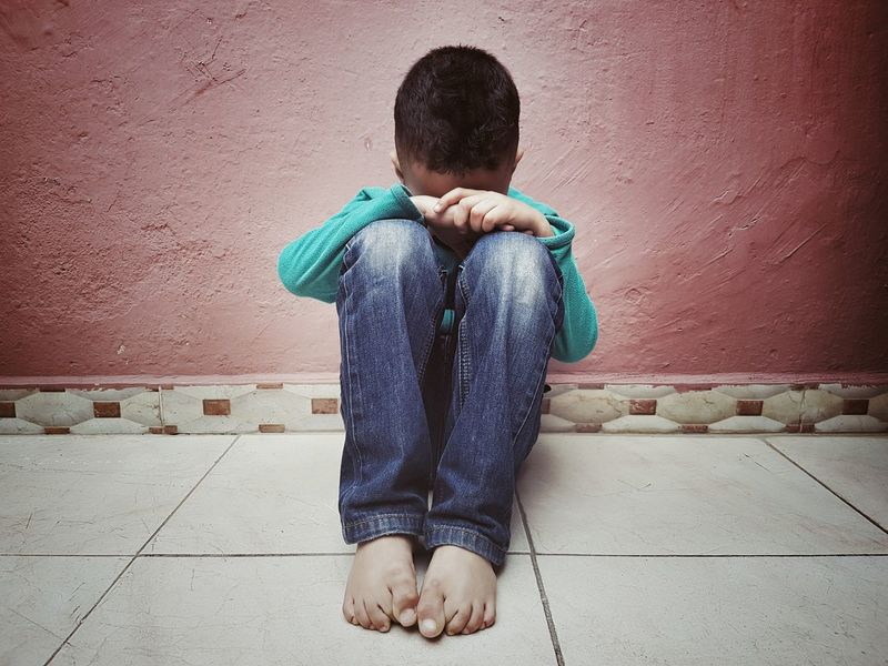 Sad kid Alone Lonley Gesture Fear Crying Child Childhood Boys Males  Depression - Sadness Sadness Crying Face Down  Disappointment Child Abuse Embarrassment Bad News Guilt Teardrop Hopelessness