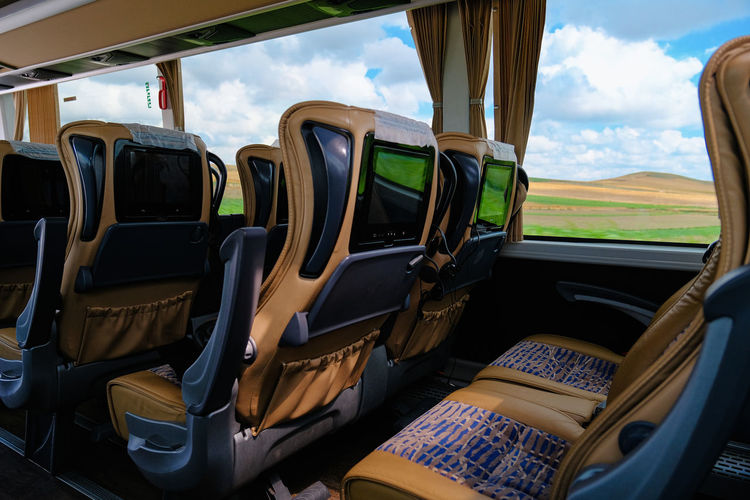 Mode Of Transportation Transportation Vehicle Interior Sky Land Vehicle Glass - Material Day Environment Land Car Landscape Transparent Cloud - Sky Window Nature No People Outdoors Vehicle Seat Field Travel