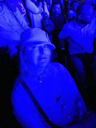 Aphex Twin Field Day Festival  2017 London Baseball Cap Night Blue Performance Music Audience Enjoyment Illuminated Human Face Looking At Camera Memories Festival Lighting Effect Sat Seated Woman Smile