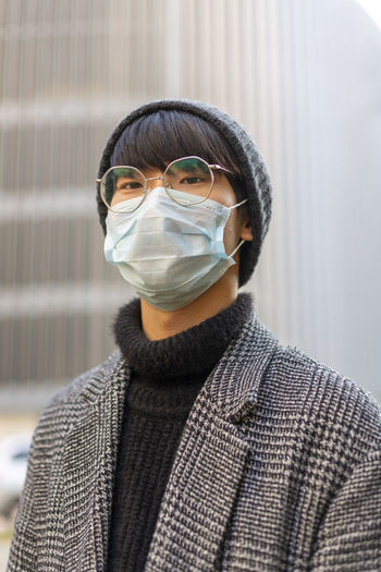 Portrait of young man wearing mask
