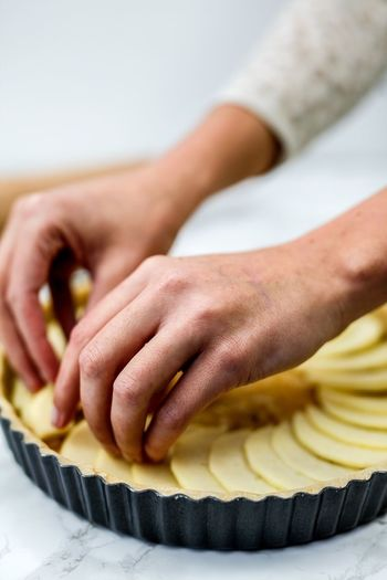 Close-up of woman preparing apple pie