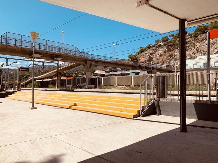 Empty railroad station platform against clear sky