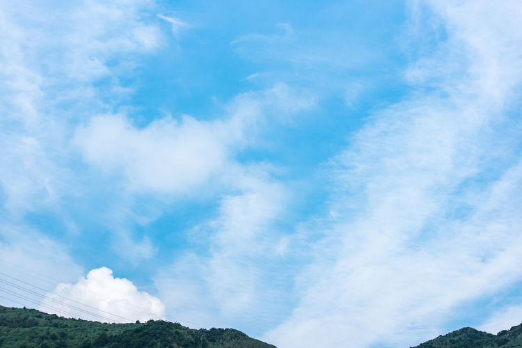 Cloud - Sky Sky Beauty In Nature Scenics - Nature Blue Day Tranquility Low Angle View Tranquil Scene No People Nature Mountain White Color Non-urban Scene Idyllic Outdoors Environment Tree Plant Landscape