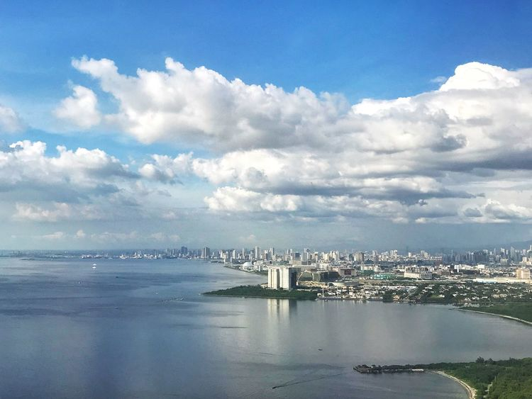 Sky Cloud - Sky Architecture Built Structure Building Exterior Sea No People Water Outdoors Nature Day Cityscape City Beauty In Nature Scenics Eyeem Philippines EyeEm Gallery Eyeemphotography EyeEm Best Shots From An Airplane Window From My Point Of View Travel Photography