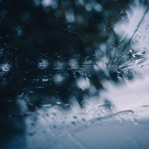 Full frame shot of wet windshield of car