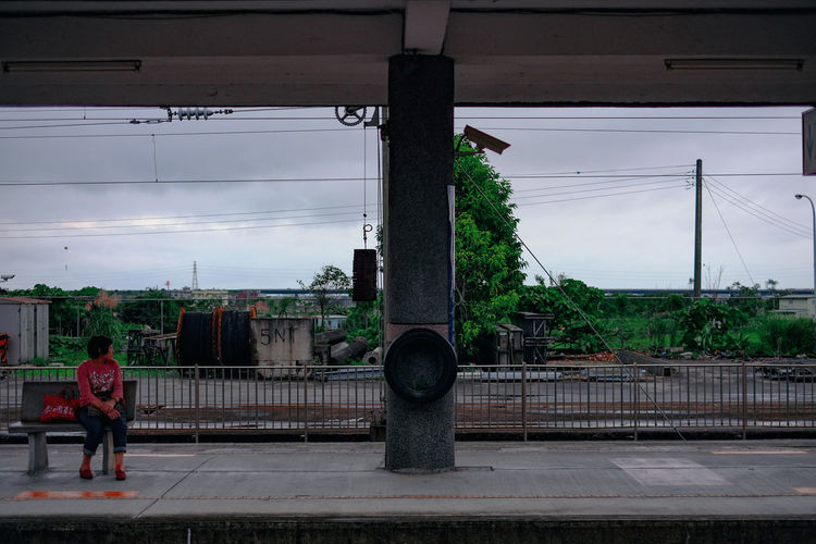 A small railroad station at Taiwan. Taiwan Architecture Building Exterior Built Structure Cloud - Sky Day Fujifilm Fujifilm_xseries Full Length Leisure Activity Lifestyles Mode Of Transportation Nature One Person Outdoors Rail Transportation Railroad Station Railway Real People Sky Taipei Transportation