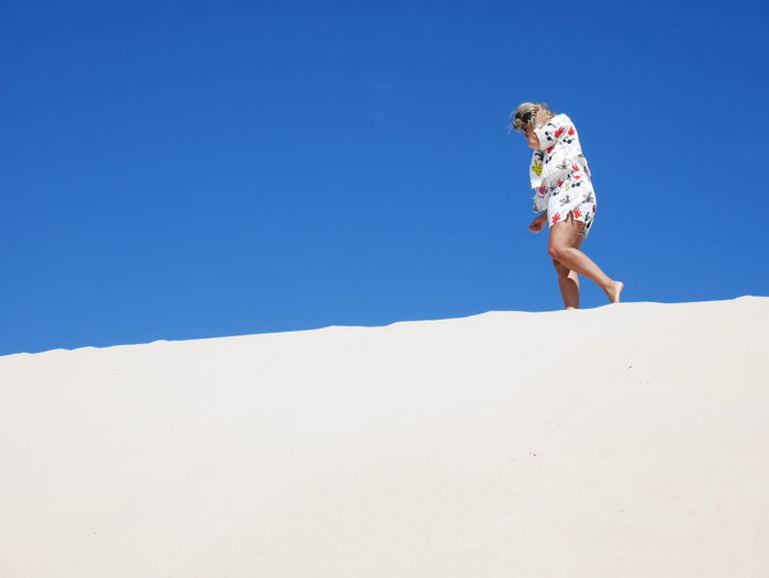 Full Length Sky One Person Nature Land Copy Space Day Lifestyles Blue Clear Sky Real People Leisure Activity Sand Sunlight Low Angle View Holiday Women Outdoors Trip