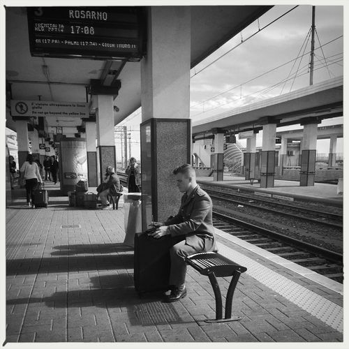Waiting for the Train. Be. Ready. Be.Ready EyeEm EyeEm Best Shots EyeEmNewHere Soldier Waiting Architecture Day Full Length Luggage Men One Person Outdoors Passenger People Public Transportation Rail Transportation Railroad Station Railroad Station Platform Railroad Track Real People Sitting Transportation Waiting The Street Photographer - 2018 EyeEm Awards