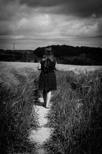 My beautiful youngest daughter walking through stormy cornfields Enjoying Life Blackandwhite Capture The Moment THESE Are My Friends Relaxing Walking Away Cornfield My Daughter My Daughter ♥ EyeEm Nature Lover Nature On Your Doorstep Natural Beauty EyeEm Best Shots - Black + White Enjoying Nature