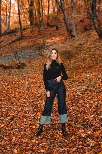 Full length of young woman in autumn