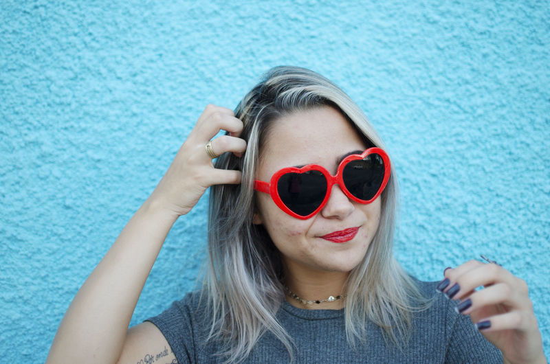One Person Portrait Glasses Sunglasses Headshot Front View Young Women Lifestyles Young Adult Hair Leisure Activity Fashion Women Heart Shape Day Real People Beauty Smiling Hairstyle Beautiful Woman Outdoors Blue Red Heart International Women's Day 2019