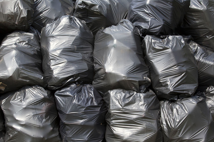 A pile of black garbage plastic bags Contamination Environmental Pollution Junk Trash Trash Bags Background Black Concept Consumerism Ecology Ecology Problem Environment Environmental Probleme Garbage Garbage Bags No People Pile Plastic Pollution Problem Recycle Recycling Waste Waste Management