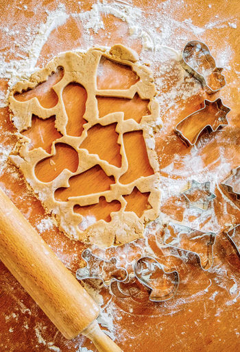 Directly above shot of various shapes on gingerbread dough