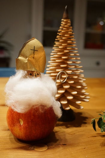 Santa Claus Made Of Apple By Popsicle Stick Christmas Tree On Table