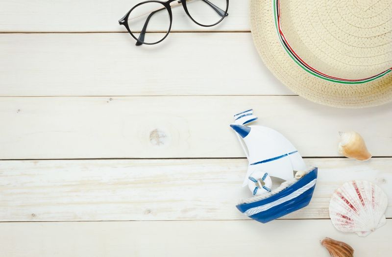 Sea Vacations Still Life Indoors  Art And Craft No People High Angle View Wood - Material Table Craft Creativity Glasses Hat
