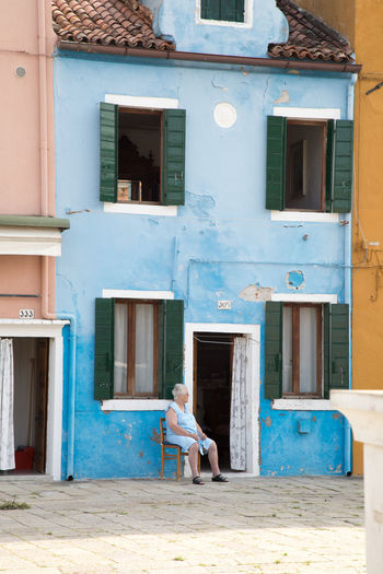 Blue House Building Exterior Day One Person Outdoors Sitting In The Shade Tranquility Travel Destinations Travel Photography
