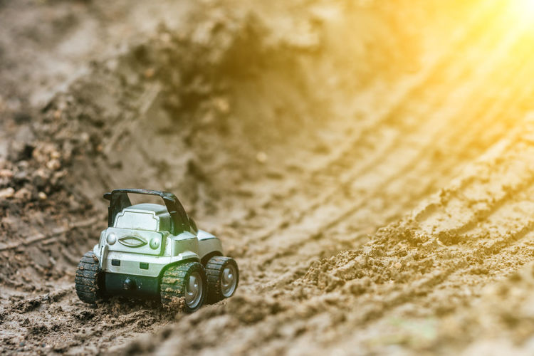 Car Competition Day Dirt Driving High Angle View Land Vehicle Mode Of Transportation Motion Motor Vehicle Nature Outdoors Selective Focus Speed Sport Sports Race Toy Toy Car Transportation