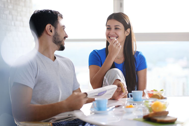 Young man and woman having food
