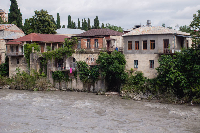 Architecture Float Georgia Kutaisi Summertime Apartment Architecture Building Exterior Built Structure City On Water Course Day House House On Water No People Old City Outdoors Residential Building Residential District Residential Structure River Summer