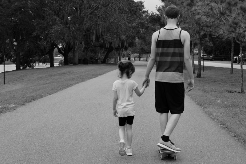 Father & Daughter (Modern) Black and White Full Length Rear View Tree Two People Plant Child Togetherness Men Real People Childhood Casual Clothing Males  Day Walking City Lifestyles Leisure Activity Positive Emotion Outdoors Shorts Father Father And Daughter Love Skateboarding