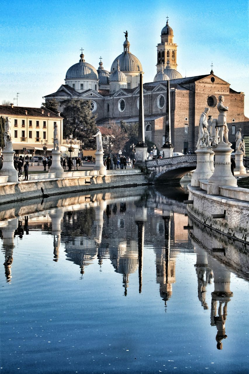 architecture, religion, building exterior, built structure, place of worship, spirituality, reflection, history, water, sky, outdoors, day, dome, travel destinations, no people, baroque style, city