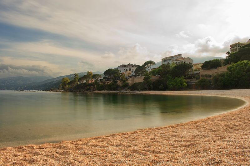 Sardinia Cala Gonone Long Exposure Water Sky Cloud - Sky Beauty In Nature Tree Plant Nature Tranquility No People Scenics - Nature Tranquil Scene Reflection Outdoors Beach Day