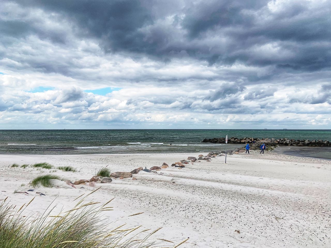 cloud - sky, sky, water, land, beach, sea, nature, day, group of people, sand, beauty in nature, scenics - nature, horizon, horizon over water, real people, incidental people, tranquil scene, overcast, outdoors