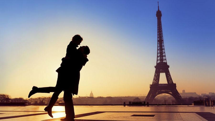 Silhouette of couple against eiffel tower