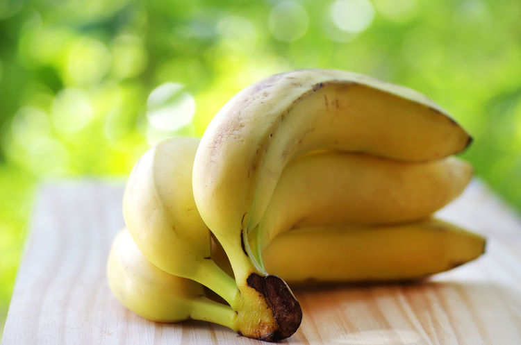 bunch of bananas Bunch Banana Close-up Food Fruit Green Color Ripe Selective Focus Table