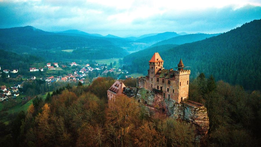 Dji Aerial Pfalz Pfälzerwald EyeEm Selects Architecture Mountain Tree Built Structure Building Exterior House History Sky High Angle View Nature Mountain Range Beauty In Nature Outdoors Roof Landscape Scenics
