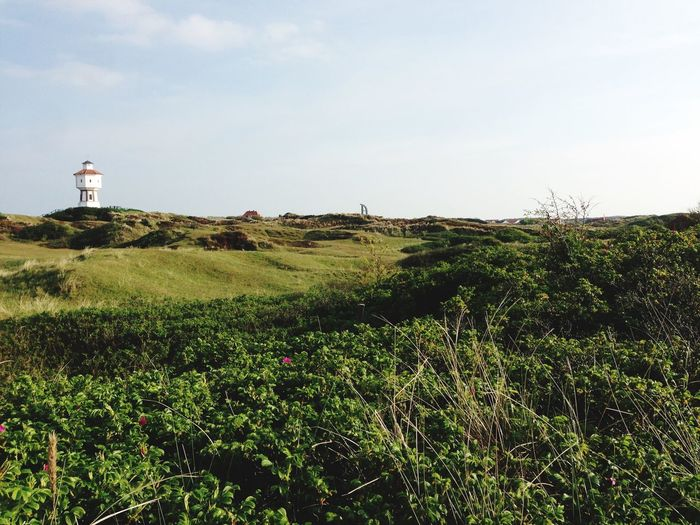 Low angle view of lighthouse at langeoog against sky