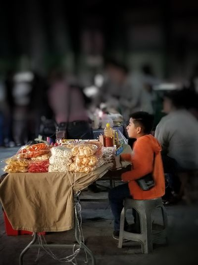 Street vendor child past midnight in Mexico Poverty Child Labour Mexico Poverty Monterrey Working Day Nightphotography Tourist Attraction  Food And Drink Vendor Market Stall Market Vendor Street Market Pastry Stall Street Food Dessert Macaroon Market Selling Concession Stand Bazaar For Sale Farmer Market
