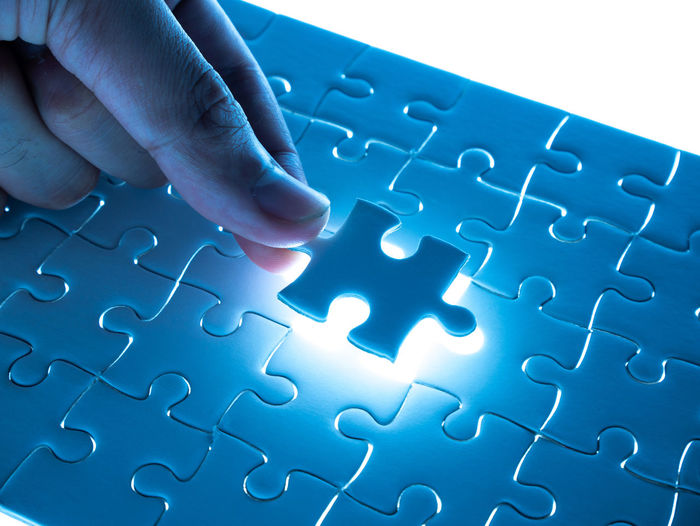 Jigsaw Puzzles Blue Body Part Close-up Complexity Connection Finger Hand Human Body Part Human Finger Human Hand Indoors  Inserting Jigsaw  Jigsaw Piece Jigsaw Puzzle Leisure Activity Leisure Games Pattern People Puzzle  Relaxation Solution Strategy