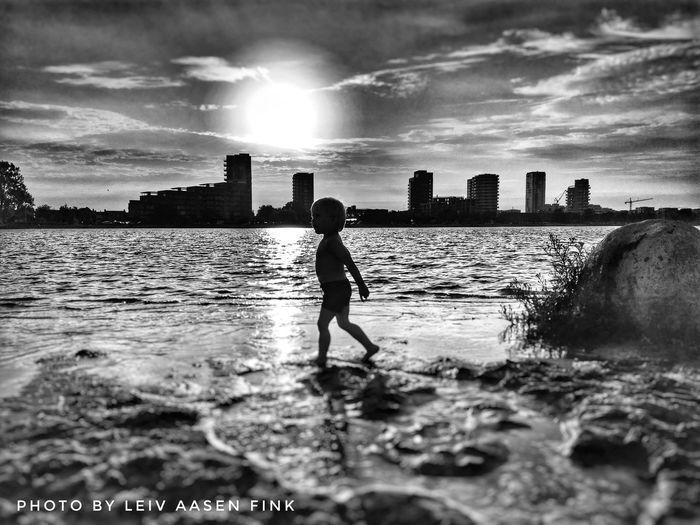 Summer in the city Eyeemphotography Instadaily EyeEm Gallery EyeEm Selects EyeEmBestPics Instadaily Instagood EyeEm Best Shots Blackandwhite Photography Eyeemphotography EyeEm Best Shots - Black + White EyeEm Masterclass EyeEmbestshots Blackandwhite Photography Water Sky One Person Built Structure Real People Architecture Full Length Building Exterior Cloud - Sky Sea Nature City Silhouette Land Outdoors Cityscape