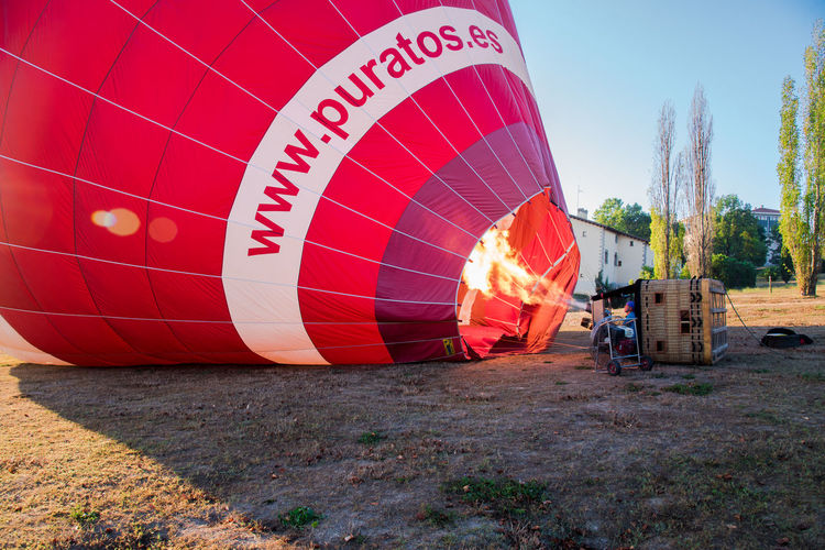Adventures Hot Air Balloons Tranquility Travel Travel Photography Activity Adventure Balloon Ballooning Festival Clear Sky Day Early Morning Fire Flying Hot Air Balloon Leisure Activity Nature Outdoors People Red Sky Sunrise Transportation Travel Destinations Tree