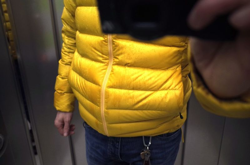 Close-up of man standing on yellow fabric