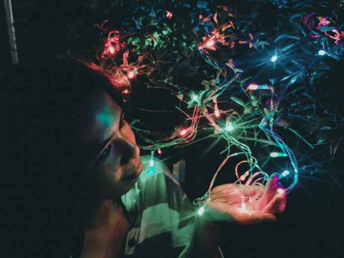 Close-up of illuminated woman