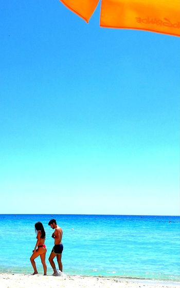 Beach Sea Sky Vacations Adult Togetherness Blue Summer Horizon Over Water Sand Clear Sky Outdoors Young Adult Happiness EyeEm Best Shots EyeEm Selects EyeEmNewHere Beachphotography Beachlovers Tranquil Scene Seascapes Beach Day Loversbeach Lovers On The Sun ☀ Boy And Girl