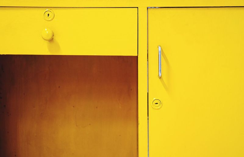 Close-Up Of Yellow Table And Locker