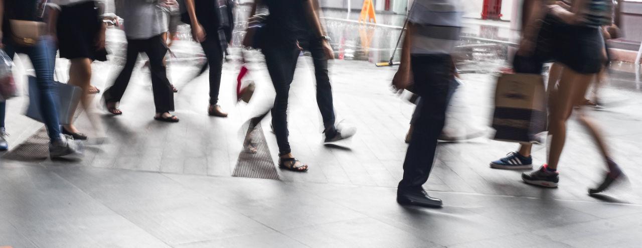 Low section of people walking in corridor