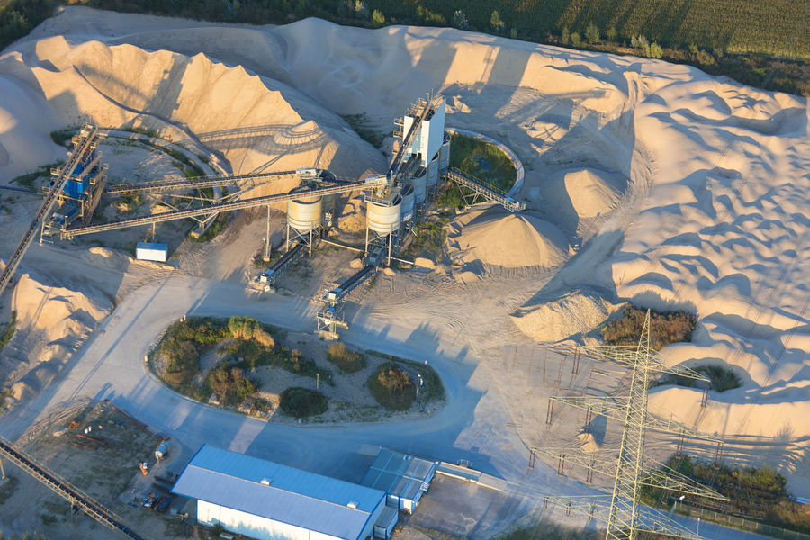 Sand quarry in the Lower Rhine Region of Germany - Wesel, North Rhine-Westfalia, Germany, Europe Business Construction Construction Site Conveyor Belt Industrial Industry Machinery NRW Winning Workplace Aerial View Concrete Digging Exploitation Germany Heap High Angle View Landscape Material Mining No People Quarry Sand Sand Quarry Sandy