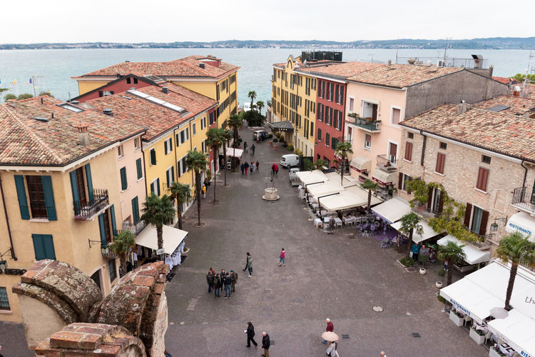 Sirmione, Italy - October 01, 2015 : View of the city from the height of the Castello Scaligero fortress wall in Sirmione, Italy Architecture Building Castello Castle Day Destination Europe Famous Fortification Fortress Garda Italy Lago Lake Lombardy Medieval Old Outdoors Scaliger Sirmione Tourism Tower Travel Wall Water
