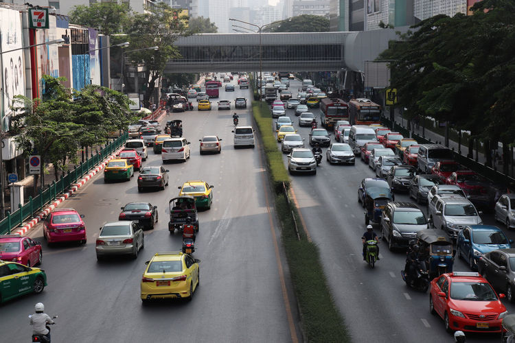 Traffic jam in Siam Center Bangkok Of City Cars Life Thailand Traffic Jam Architecture Building Exterior Built Structure Car City City Street Day High Angle View Land Vehicle Mode Of Transport Motorcycle No People Outdoors Road Siam Street Traffic Transportation