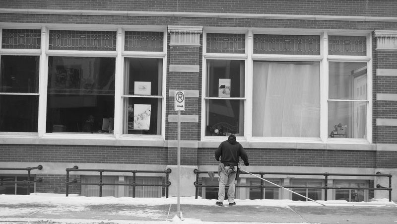 December 19, 2016 / Downtown Fargo Adult Architecture Black And White Building Exterior Built Structure Day Downtown Fargo Fargo Full Length Lifestyles Men Monochrome North Dakota One Person Outdoors Real People Window