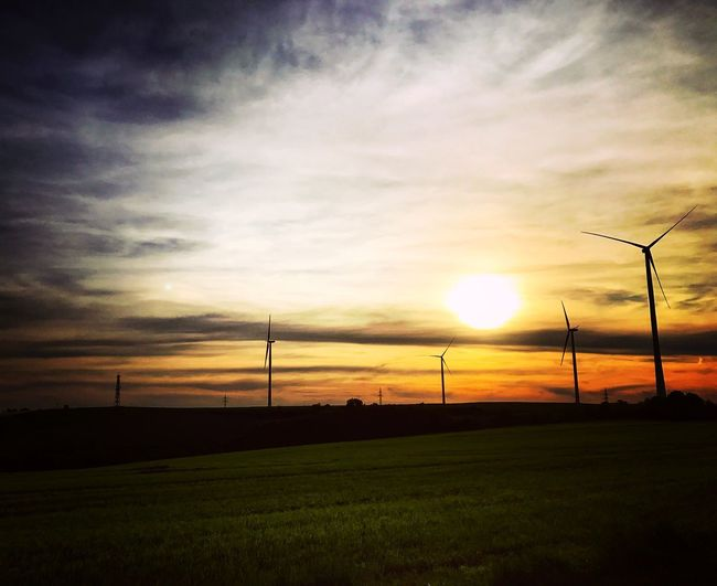 Windenergieanlagen Windpower Electricity  Windcraft Sky Sunset Cloud - Sky Sun Scenics - Nature Beauty In Nature Tranquil Scene Tranquility Environment Silhouette Landscape Field Grass Nature Sunlight No People Orange Color Technology Plant Land