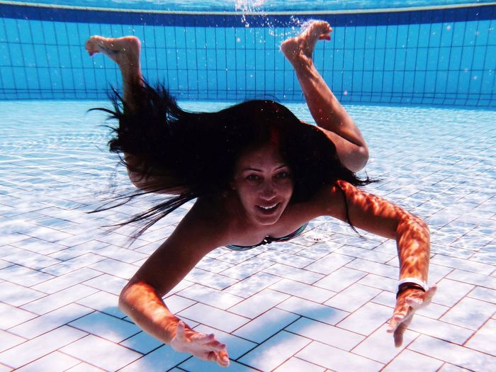 Smiling Woman Swimming In Pool