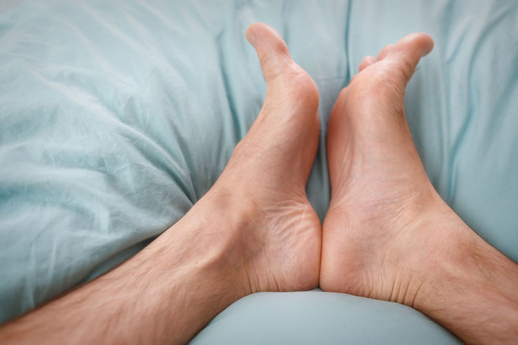 barefoot Bed Bedroom Close-up Comfortable Day Human Body Part Human Foot Human Leg Indoors  Low Section Lying Down Men One Man Only One Person People Real People Relaxation Sheet Sole Of Foot