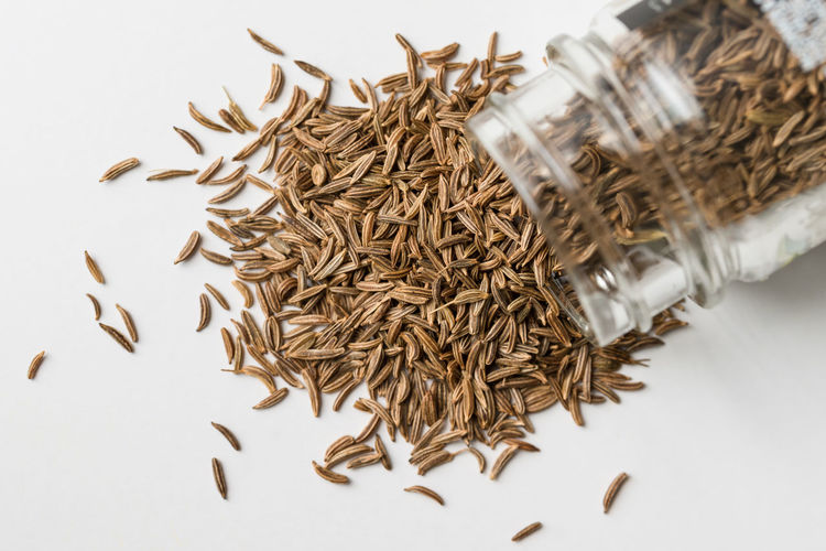 Caraway Seeds Spilling from Spice Jar Raw Food Food Close-up No People White Background High Angle View Spice Jar Herb Caraway Seeds Macro Top View Isolated Nobody Ingredient